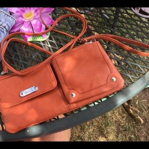 Relic tangerine leather wristlet with should strap